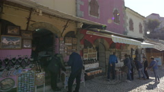 View of a group of people buying souvenirs from a souvenir shop in Mostar Stock Footage
