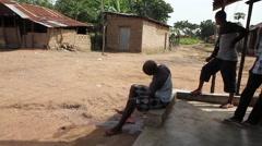 Africa villager man washing to pray Stock Footage