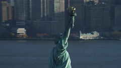 Orbiting the upper portion of the Statue of Liberty, revealing Ellis Island with Stock Footage