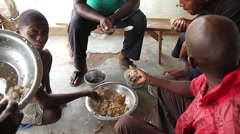 Africa villagers eating lunch Stock Footage