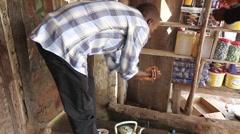 Native villager man washing to pray Stock Footage