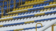 Yellow Blue Chairs Covered With Snow at Stadium Stock Footage