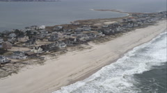 Flying past beachfront homes in West Hampton Dunes on Long Island, New York. Stock Footage