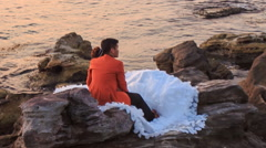 Closeup Backside Girl Guy Admire Scenery Sit on Rocks by Sea Stock Footage