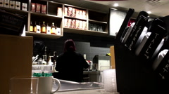 Worker preparing ice coffee for customer inside Starbucks Stock Footage
