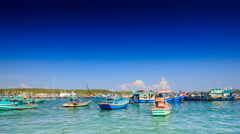 Distant View of Vietnamese Fishing Boats in Bay against Sky - stock footage