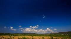 White Cumulus Clouds Motion in Blue Sky over Rural Landscape Stock Footage