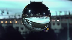 Ice skate pond through nikon ball Stock Footage