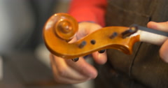 Violin maker Cine 4k [External audio] - details Stock Footage