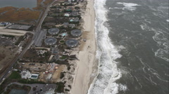 Flying over beachfront residential area west of Shinnecock County Park, Long Stock Footage