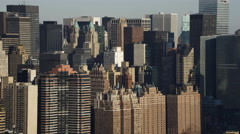 Close flight past Midtown Manhattan from the East River side. Shot in 2011. - stock footage