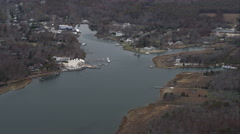 Flying over homes along an inlet near Hampton Bays, New York. Shot in November Stock Footage
