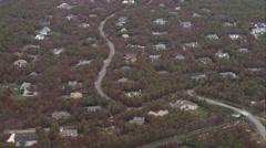 Flying over homes among autumn woodland near Hampton Bays, New York. Shot in Stock Footage