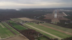 Flying over farmland near East Hampton Airport in Wainscott, New York. Shot in Stock Footage