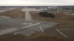 Approach to landing at East Hampton Airport in Wainscott, New York. Shot in Stock Footage
