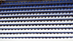 Blue chairs covered with snow at the stadium Stock Footage
