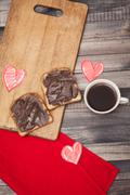 Coffee, toast and chocolate paste, romantic breakfast on Valentine's Day Stock Photos