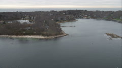Flying over homes along inlets on Fishers Island, New York. Shot in November Stock Footage