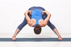 Sporty fit woman practices Ashtanga Vinyasa yoga - stock photo