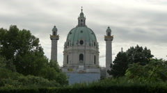 View of Karlskirche, a crane and trees in Vienna Stock Footage