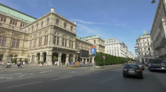 People walking and cars driving near Wiener Opernball in Vienna Stock Footage