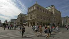People crossing the street and stopping at the red light near the opera Vienna Stock Footage