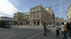 View of people and cars driving near the opera in  Vienna Stock Footage