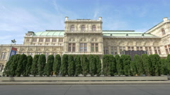 View of cars driving and trees in front of the opera in Vienna Stock Footage