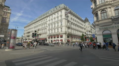 People walking on Philharmoniker Strasse, cross to Kärntner Strasse, Vienna Stock Footage