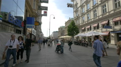 Walking on Kärntner Strasse, on a sunny day in Vienna Stock Footage