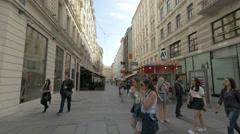 Walking on Kärntner Strasse cross to Krugerstrasse, Vienna Stock Footage