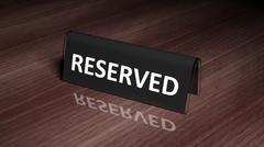 Black glossy reservation sign on wooden surface with reflection Stock Photos