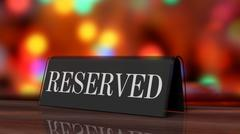 Black glossy reservation sign on wooden surface, with festive background. - stock photo