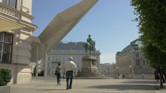 Tourists walking near the Statue of Archduke Albert in Vienna Stock Footage