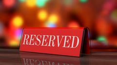 Red glossy reservation sign on wooden surface, with festive background. - stock photo