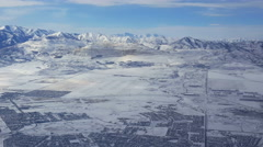POV- View of snow covered mountains copper mine and suburbs from airline Stock Footage