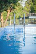 Outdoor swimming pool with shiny water Stock Photos