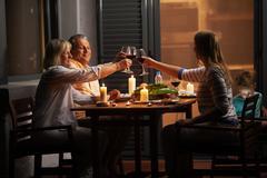 Quiet family dinner in the backyard Kuvituskuvat