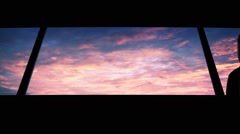 Man Looks Out At Amazing Sunset - stock footage