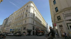 Riding a bike and walking on Tegetthoffstrasse in Vienna Stock Footage