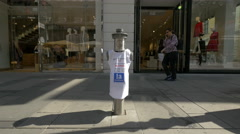 Hydrant with shirt in front of a shop in the city center of Vienna Stock Footage