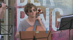 Man playing cello in the center of Vienna Stock Footage