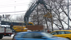 Working excavator on a street in Moscow Stock Footage