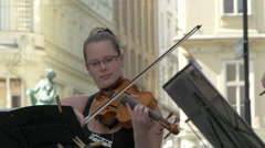 Woman playing the violin in the center of Vienna Stock Footage