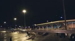 Disembark plane at night Stock Footage