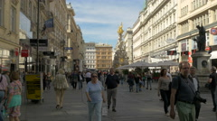 Tourists walking on Graben street, passing by Pestsaule, Vienna Stock Footage