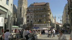 People walking by the entrance to metro in Stephansplatz, Vienna Stock Footage