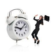 Business woman stand near big alarm clock Stock Photos