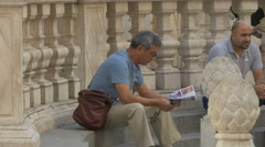 Tourist with a map sitting on stairs, Vienna Stock Footage