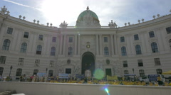 Stock Video Footage of Many people in yellow shirts gathered in front of Hofburg Palace in Vienna